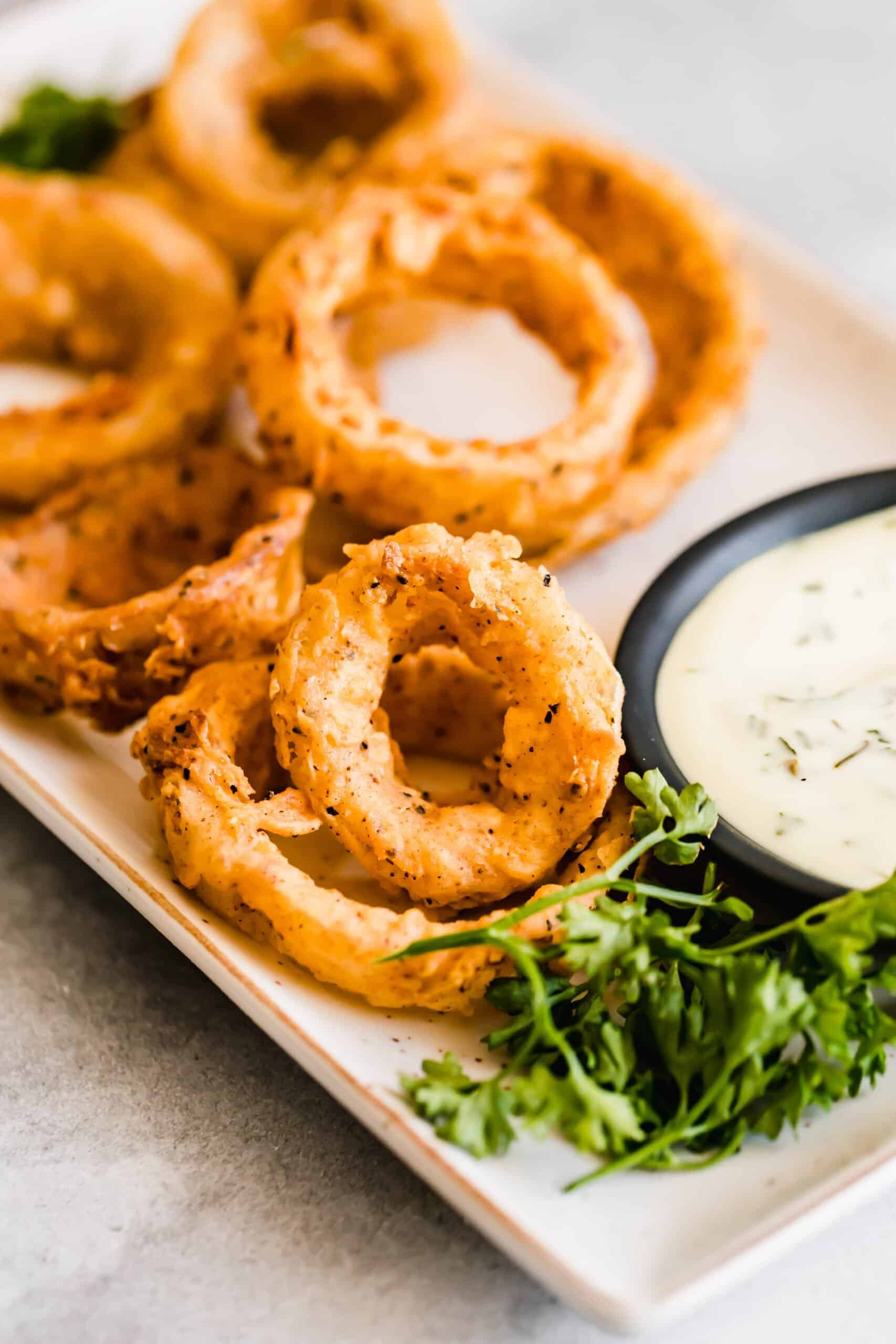Plate of onion rings with dip.