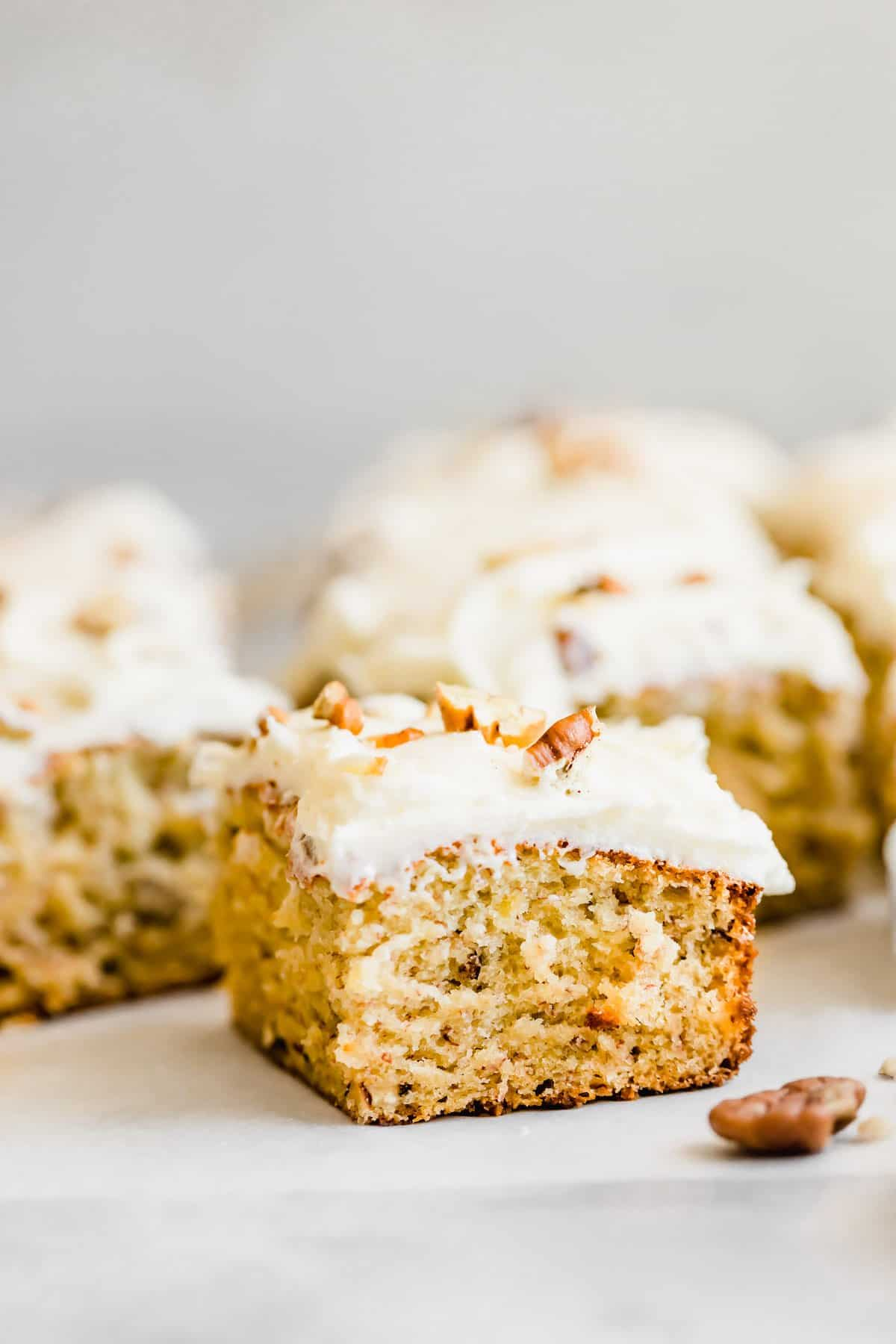 Slice of banana cake with chopped nuts.