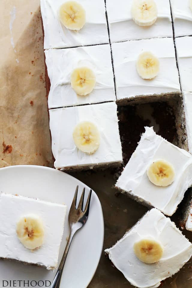 Banana Cake with Cream Cheese Frosting cut into squares.