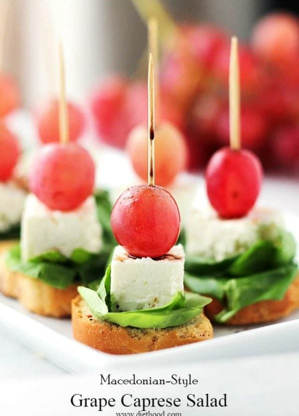 Macedonian-Style Grape Caprese Salad | www.diethood.com | This light, fresh appetizer-salad is made with red grapes, feta and spinach set atop slices of garlic toast.