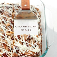 Caramel Pecan Pie Bars | www.diethood.com | Buttery crust topped with a decadent caramel mixture, a layer of pecans and a white chocolate drizzle.