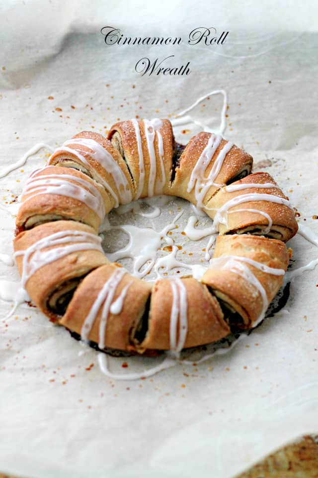 Cinnamon Roll Wreath | www.diethood.com | Festive, beautiful and delicious cinnamon roll shaped into a ring and decorated with a sweet vanilla glaze.