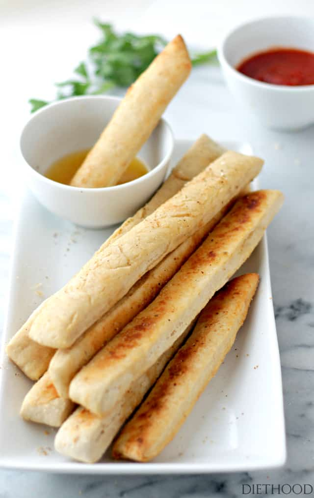Easy Garlic Parmesan Breadsticks with Garlic Dipping Sauce | www.diethood.com | Sprinkled with Parmesan Cheese and dipped in a delicious Garlic Dipping sauce, these homemade breadsticks are not only easy to make, but they come together in just 30 minutes from start to finish!