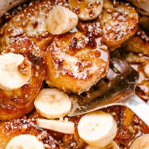 scooping out french toast from crockpot
