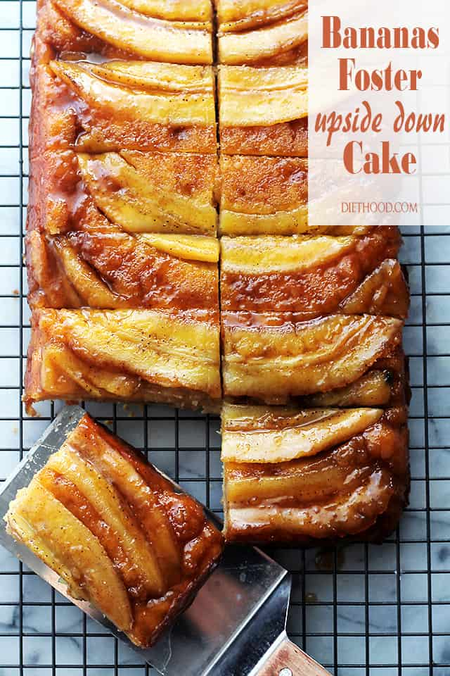 Bananas Foster Upside-Down Cake on a wire rack with a piece being removed
