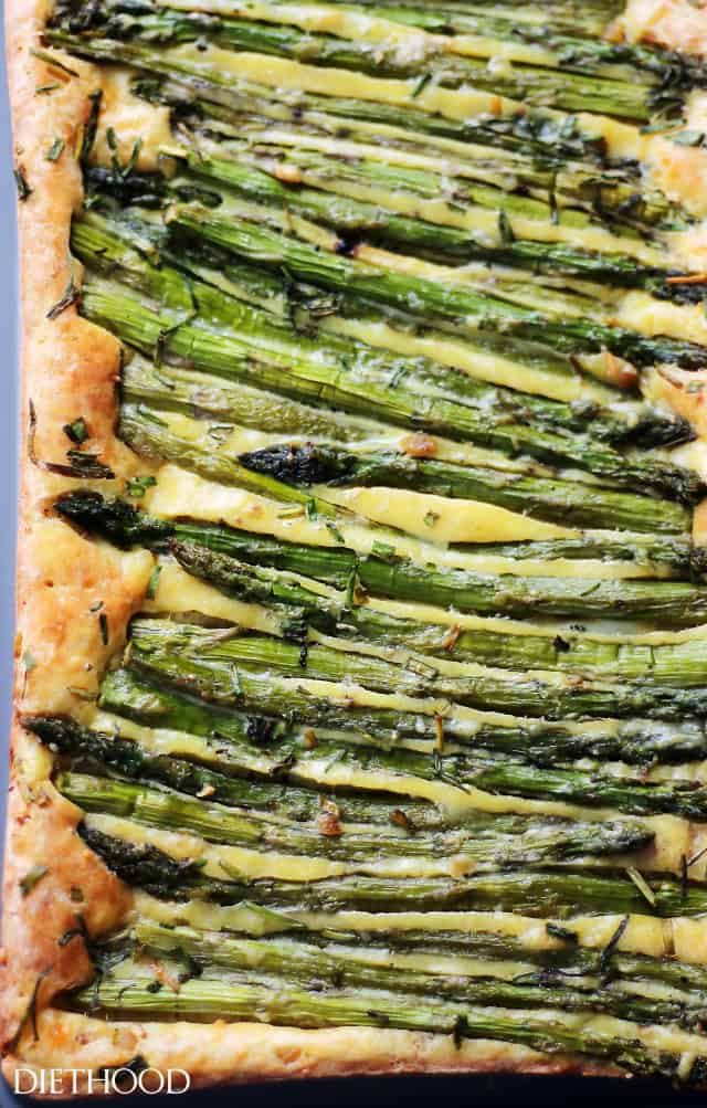 Cheesy Asparagus Frittata - Asparagus, parmesan and feta cheese incorporated into an egg batter to make this ridiculously easy, yet incredibly delicious and versatile dish!