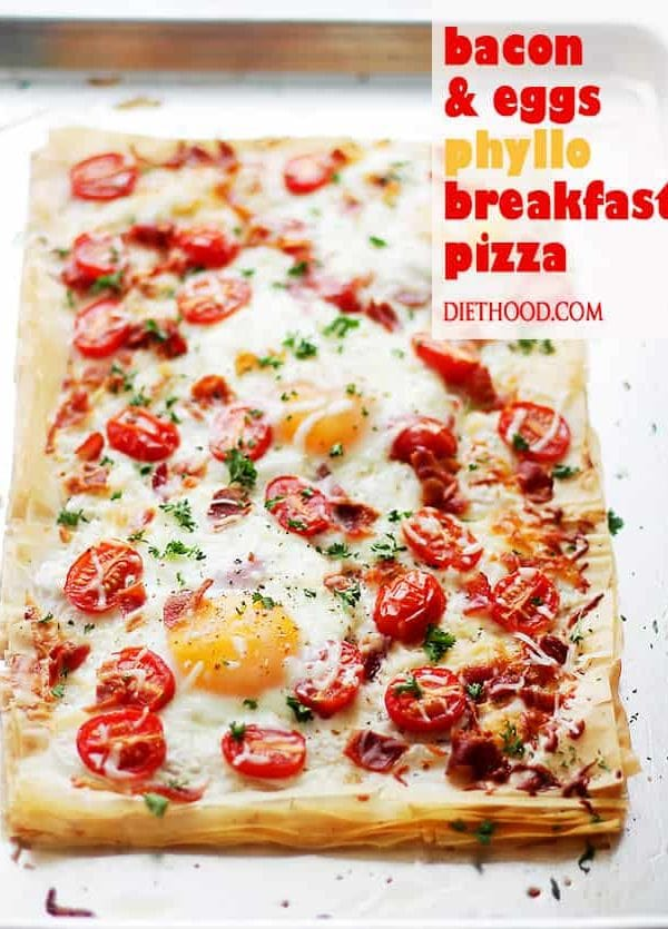 Bacon and Eggs Phyllo Breakfast Pizza | www.diethood.com | Crispy bacon, soft eggs and cherry tomatoes settled on top of phyllo sheets smothered with a seasoned feta cheese spread.