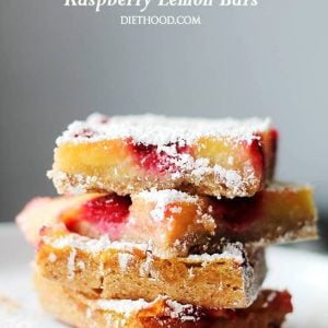 Raspberry Lemon Bars – Nutty cookie crust topped with a luscious lemon filling and studded with fresh sweet raspberries. Bursting with flavor and texture, these Lemon Bars are not only delicious, but at 150 calories per serving, they're also much lighter than your classic Lemon Bars Recipe. PUCKER UP!
