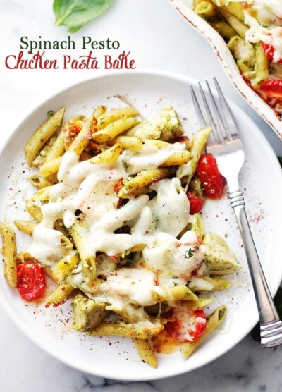 Spinach Pesto Chicken Pasta Bake - A delicious and easy recipe made with chicken, whole wheat pasta and tomatoes tossed in a creamy spinach pesto sauce and topped with cheese. This pasta is a winner every time AND it freezes great, too! Get the recipe on diethood.com