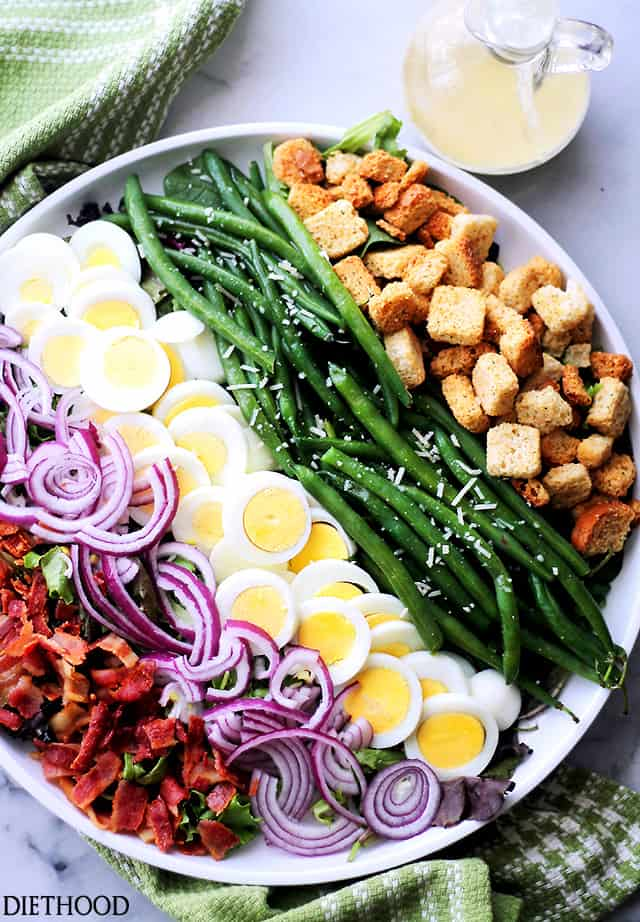 Green Bean and Egg Salad served on a large round white plate.