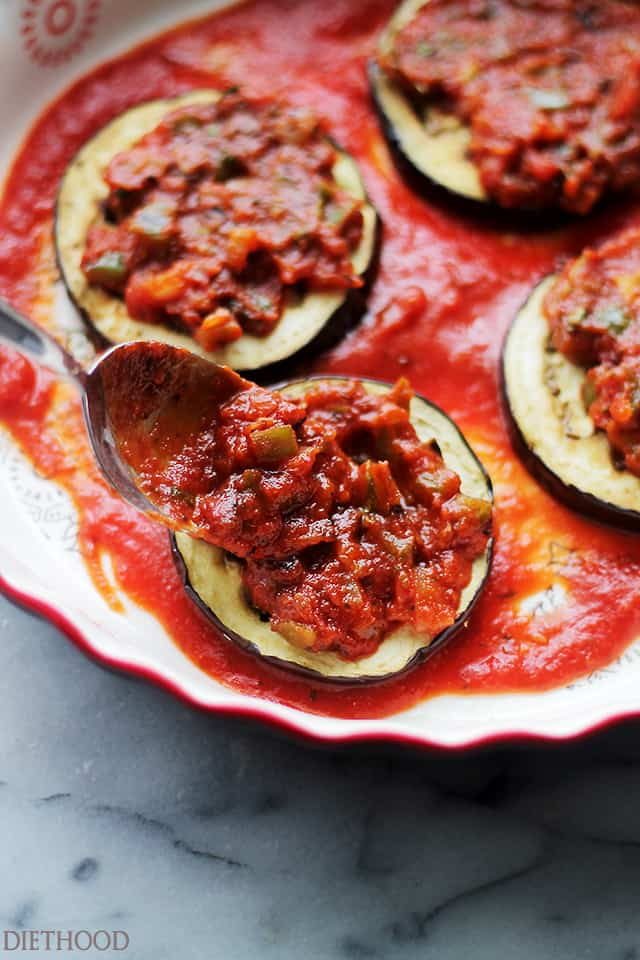 Roasted Eggplant and Tomato Sauce Stacks - A delicious combination of sweet, roasted eggplants topped with a perfectly textured tomato sauce and gooey mozzarella cheese! Get the recipe on diethood.com