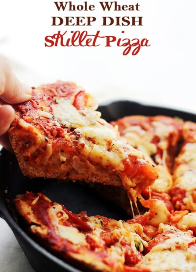 Whole Wheat Deep Dish Skillet Pizza - Soft, flavorful, homemade, MILE-HIGH Whole Wheat Pizza Dough topped with tomatoes, delicious herbs and lotsa cheese! Get the recipe on diethood.com