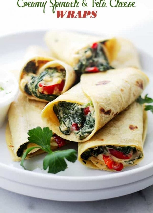 Creamy Spinach and Feta Cheese Tortilla Wraps - A deliciously creamy mixture of cheeses, peppers, spinach and feta wrapped in a flour tortilla. Get the recipe on diethood.com