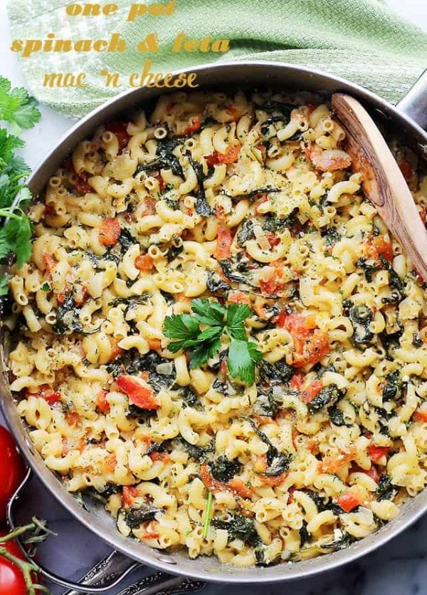 One Pot Spinach & Feta Macaroni and Cheese - Stove top, one pot Mac 'n Cheese covered in a creamy feta cheese sauce, tomatoes and fresh spinach. Dinner will be ready in 30 minutes! Get the recipe on diethood.com