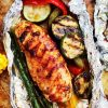Grilled Barbecue Chicken and Vegetables in Foil - Tender, flavorful chicken covered in sweet barbecue sauce and cooked on the grill inside foil packs with zucchini, bell peppers and asparagus.