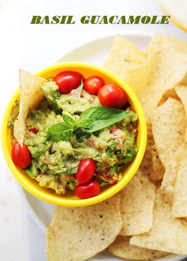 Basil Guacamole - A delicious twist on the classic guacamole made with fresh basil, tomatoes, onions and lime.