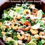 Grilled Shrimp Caesar Salad with Homemade Light Caesar Dressing - Crunchy and creamy classic caesar salad tossed with juicy grilled shrimp, garlic croutons, and a lightened-up, homemade caesar salad dressing made without egg yolks!