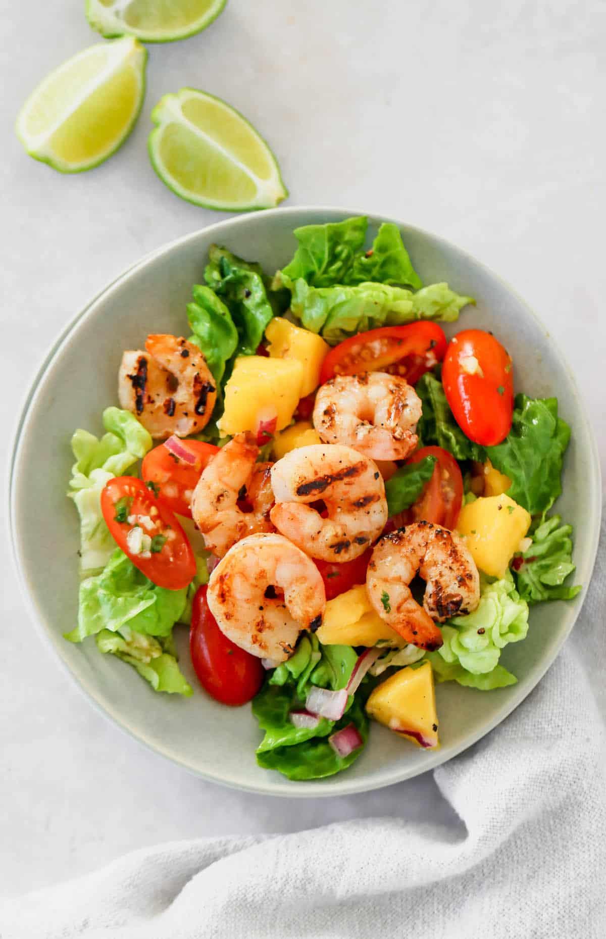 A small bowl of mango and shrimp salad