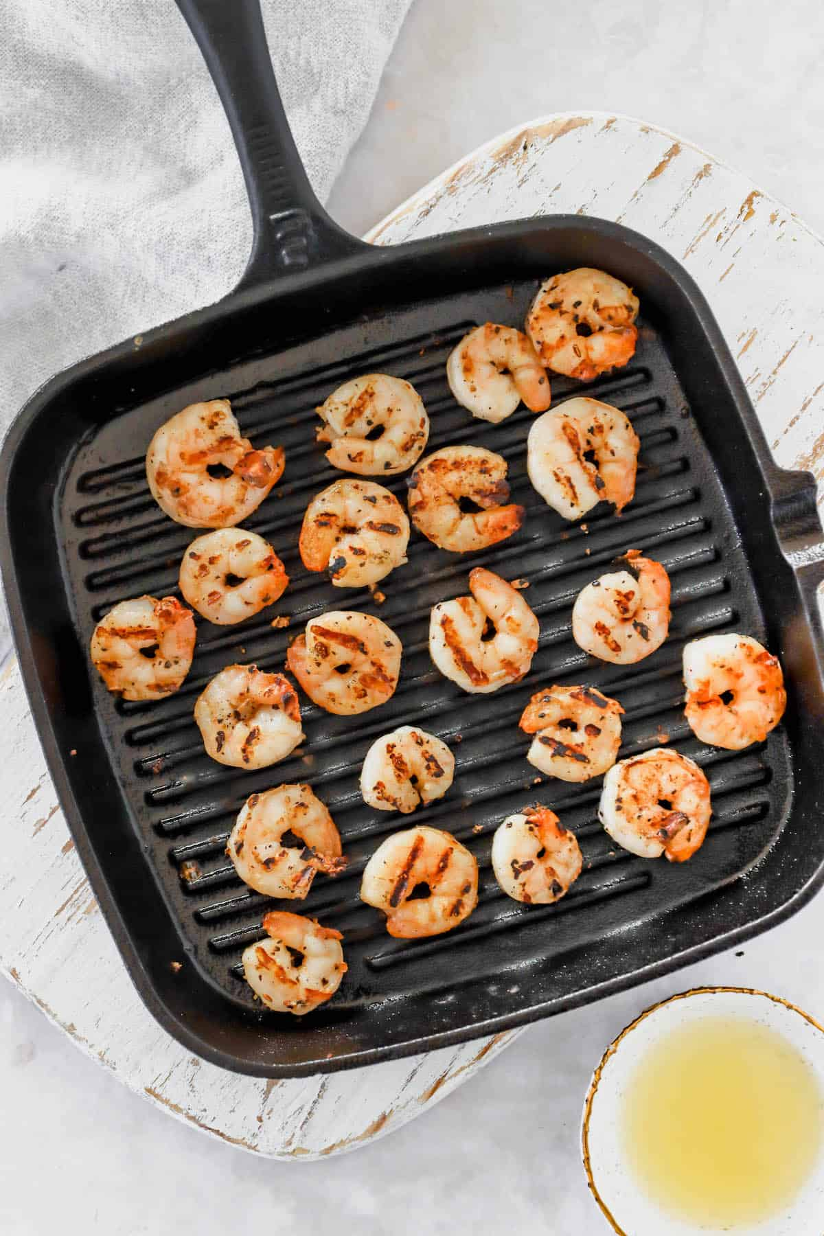 Shrimp cooking on a grill pan