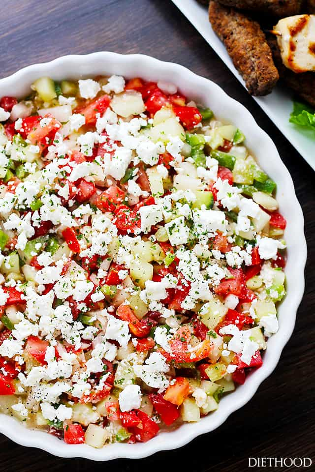 cucumbers, tomatoes, and feta cheese served in a salad bowl.