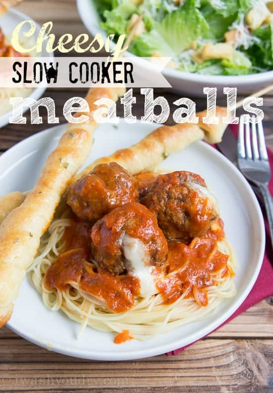 Spaghetti and meatballs on a plate with breadsticks
