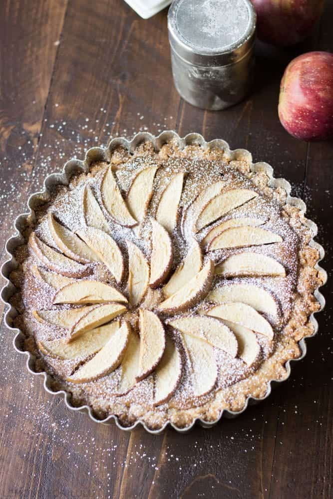 Top view of an apple tart with decorative apple slices on top