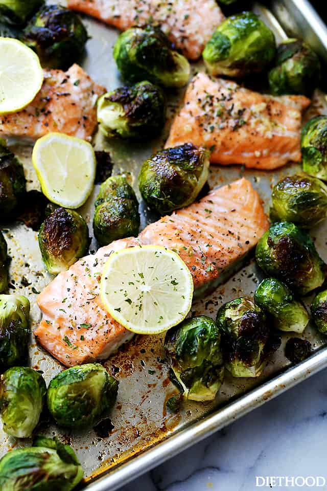 One Sheet Pan Garlic Roasted Salmon with Brussels Sprouts   www.diethood.com   Incredibly delicious, garlicky, super flavorful one-pan dinner with oven-roasted salmon and brussels sprouts.
