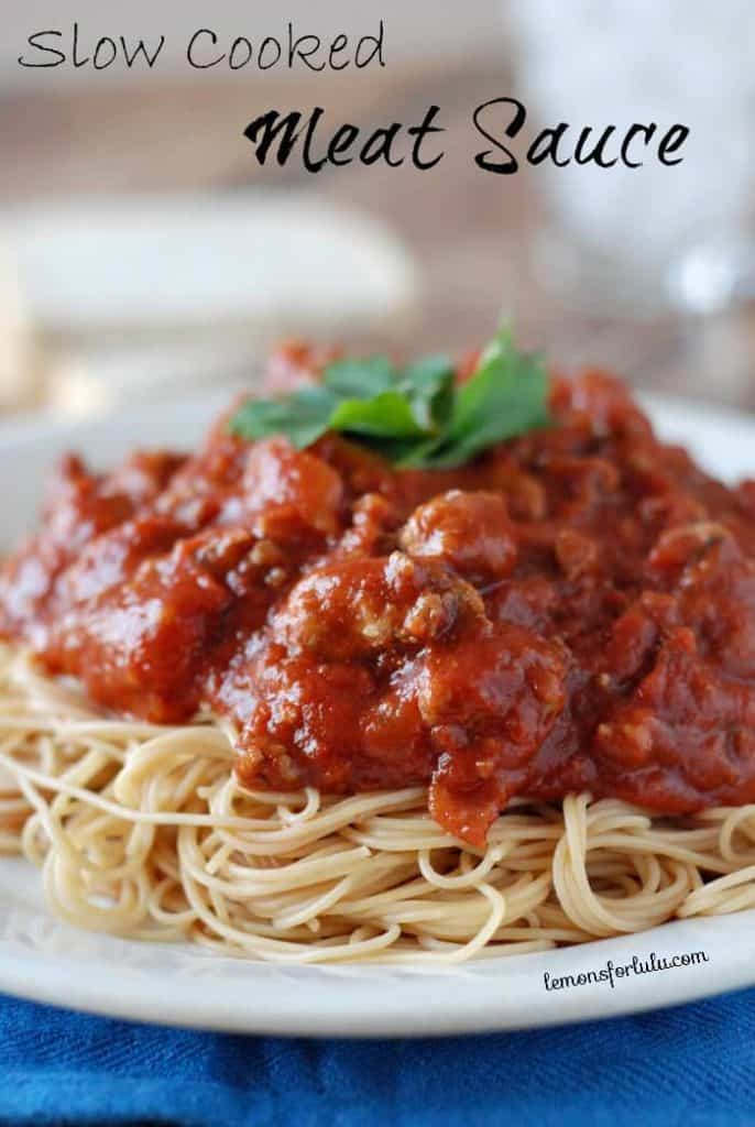 Slow cooker meat sauce over spaghetti on a plate