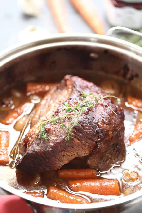 Braised Brisket in a skillet with carrots