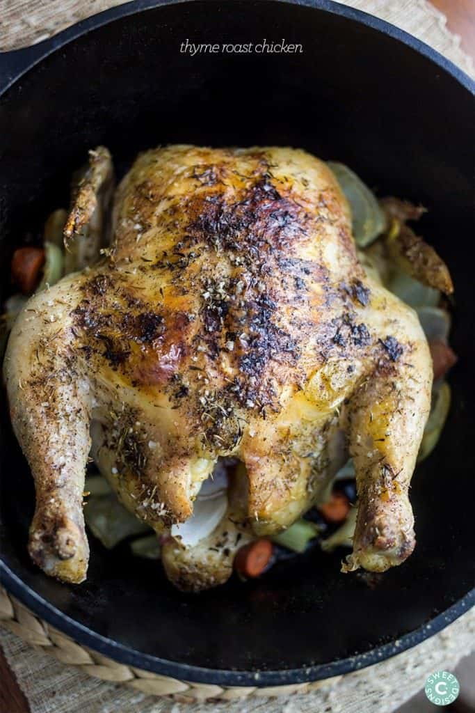 Whole roasted chicken with thyme over vegetables