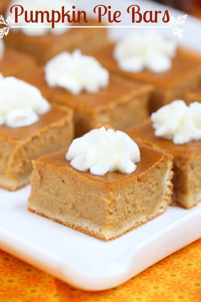 Pumpkin Pie Bars with a dot of whipped cream on top