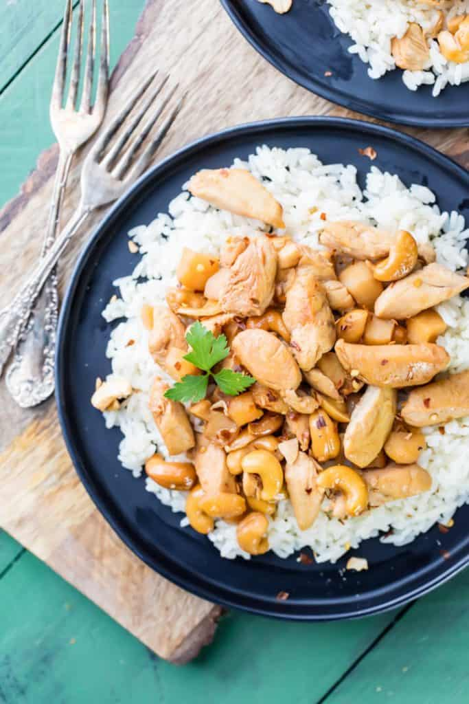 Slow cooker cashew chicken over rice in a bowl