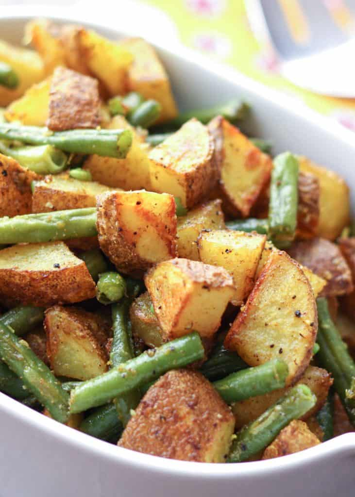 Turmeric roasted potatoes and green beans in a serving bowl