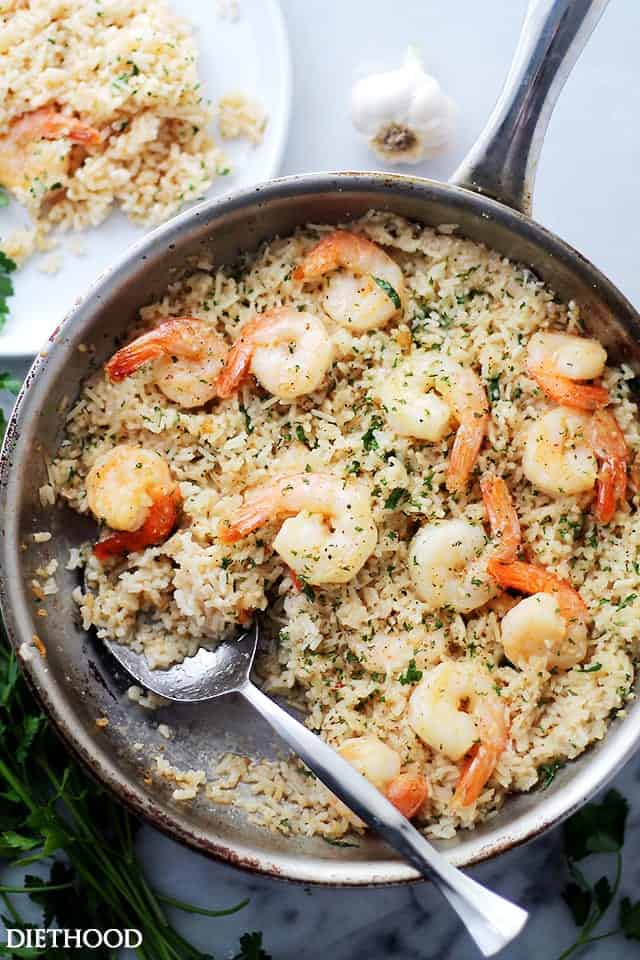 Garlic butter shrimp and rice in a skillet