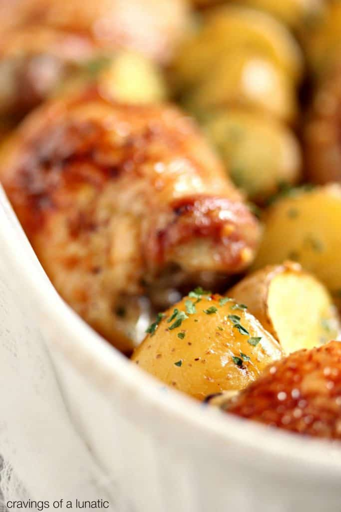 Honey Baked Chicken and Potatoes in a baking dish