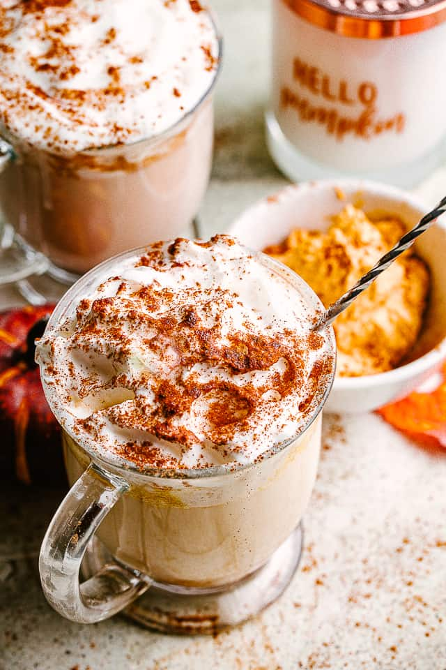 Pumpkin Spice Latte topped with whipped cream and pumpkin pie spice.