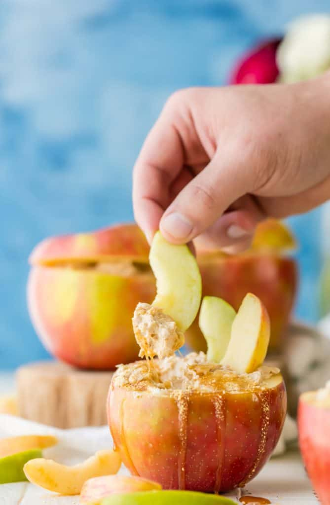 Caramel Apple Cheesecake dip in an apple with apple slices