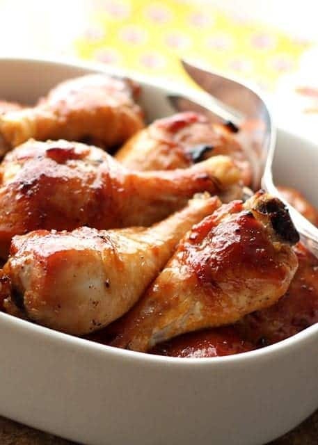 Honey Soy chicken drumsticks in an oval serving bowl