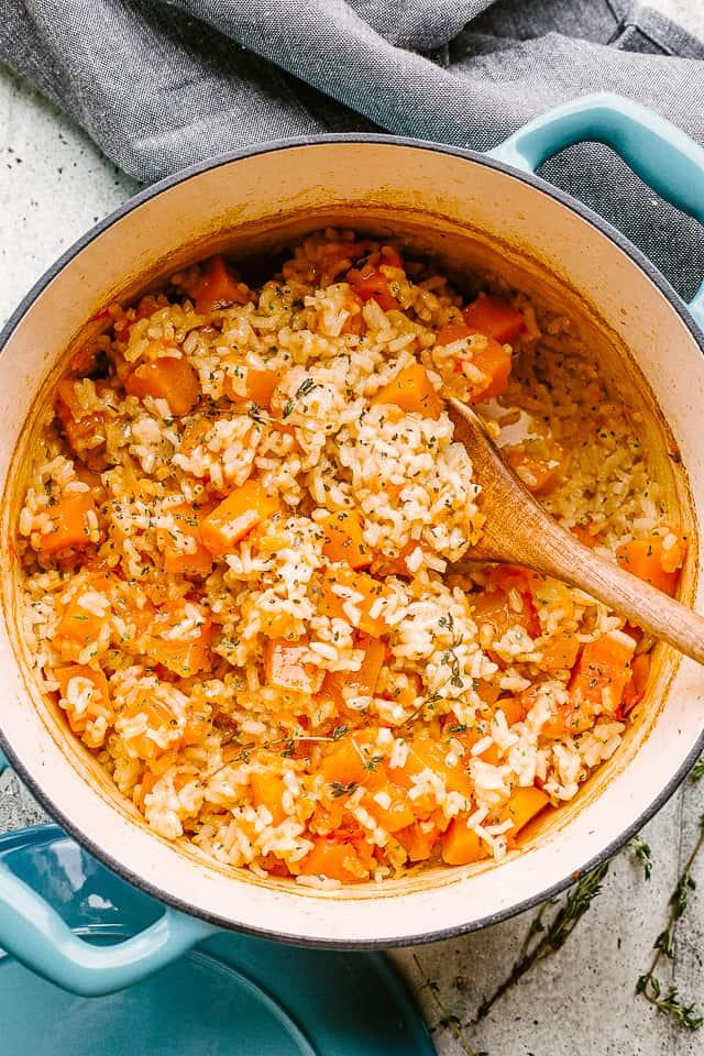 Butternut squash and rice in a Dutch oven.