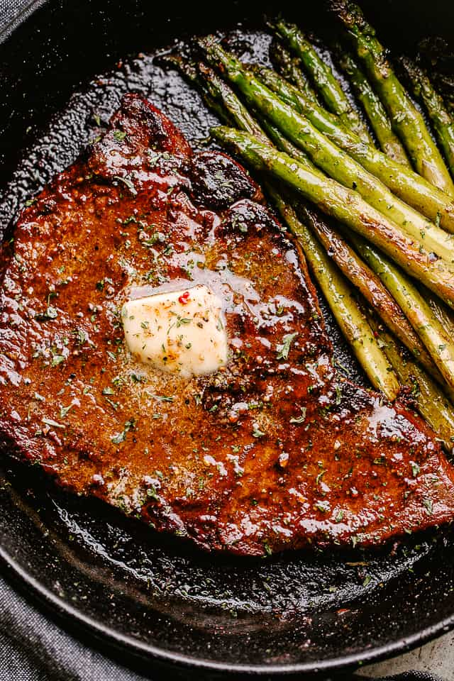cooking steak in a skillet