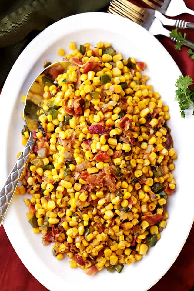Bacon and Corn Skillet Recipe - Easy and seriously delicious side dish with crispy bacon and deliciously seasoned corn with sage and shallots.