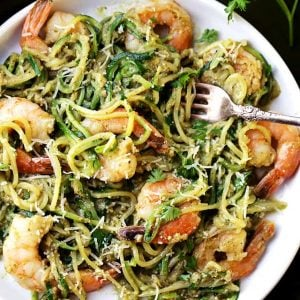 Pesto Zucchini Noodles and Shrimp - Quick and easy dinner recipe with tender zucchini noodles and perfectly sauteed shrimp tossed in a delicious basil pesto sauce.