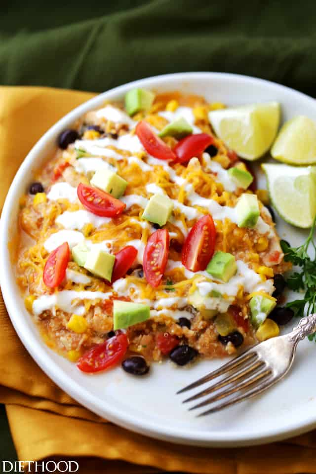 Crock Pot Salsa Chicken Quinoa Casserole Recipe - Give rotisserie chicken new life with this super simple and delicious casserole. Packed with quinoa, chicken, veggies, and salsa, this is about to become your new go-to hearty meal! All you need to do is arrange the ingredients in the crock pot and walk away.
