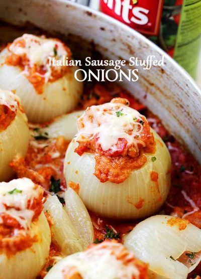 Italian Sausage Stuffed Onions - Filled with Italian sausage, tomatoes, and cheese, these Stuffed Onions are the perfect, most delicious side dish to any meal.