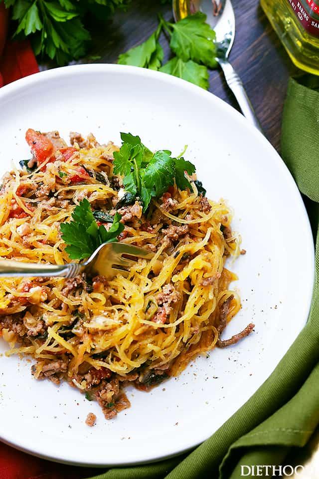 Mediterranean Spaghetti Squash Boats - Delicious, healthy, easy to make Spaghetti Squash boats loaded with ground turkey, tomatoes, kale and feta cheese.