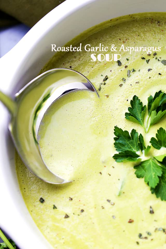Roasted Garlic and Asparagus Soup in a pot with ladle.