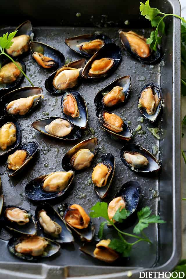 Roasted Mussels with Garlic-Butter Crumbs - These Mussels topped with garlic butter crumbs and roasted in the oven, serve perfectly as an appetizer, or over pasta for a delicious dinner.