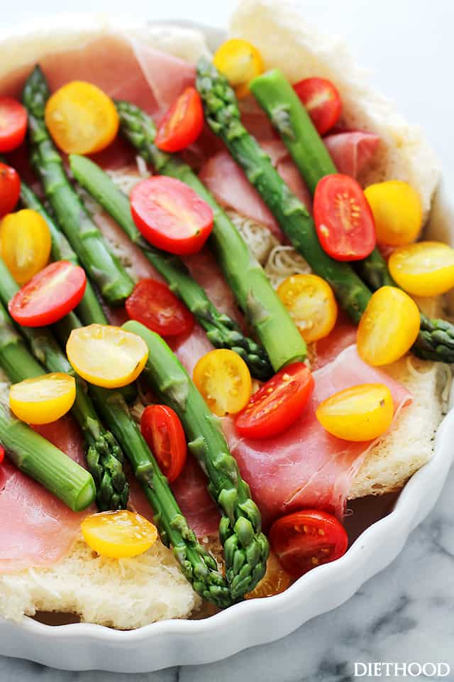 Overnight Breakfast Strata with Prosciutto and Asparagus - This delicious breakfast strata is loaded with prosciutto, tomatoes, and asparagus, and it's the best way to serve breakfast or brunch to a crowd.