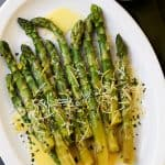 Asparagus with Lemon Butter Sauce – Budget friendly, quick, and easy crisp-tender asparagus drizzled with an amazing lemon butter sauce and a sprinkle of parmesan cheese. The BEST asparagus side dish of ever!