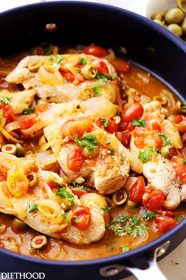 Skillet Chicken with Tomatoes and Olives - Packed with sweet tomatoes and salty olives, this delicious and easy chicken dinner is sure to impress! Easy enough for weeknights, fancy enough for dinner guests.